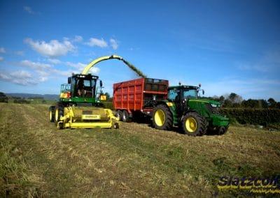 John Deere Forage Harvester chopping grass into a K2 Trailer
